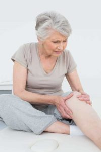 Elderly woman with knee pain