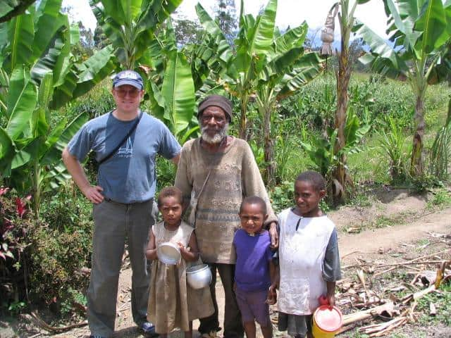 Dr. Birchard visiting a family on their small farm